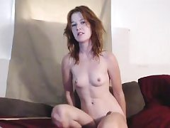 Sexy redhead babe in a tempting solo scene