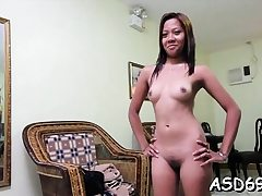 Thai whore favors a guy with penis sucking and riding