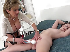 Chick Sonia teases her younger coworker with a hitachi