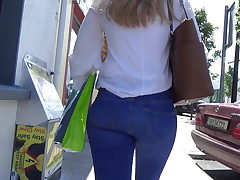 Candid platinum-blonde teen in flesh tight denim
