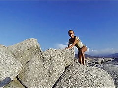 Climbing a Rock in a short Dress