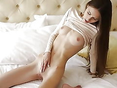 Leona relieving on a bed