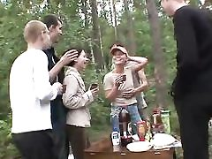 5 dudes and 2 teen femmes in the forest