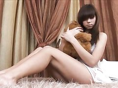 Beautiful russian teen strips on her bed