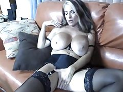 Steamy cougar with massive bosoms blowing a huge fat donger deep throat