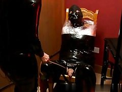 Super-naughty domina wearing latex costume manhandling his giant chisel