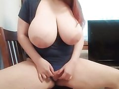 Red-haired with huge tits rubbing her pussy hole on the camera
