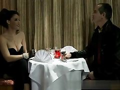 Horny couple is having a dinner before some hard core bang-out activity