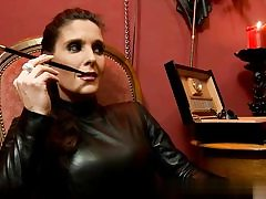 Nasty whore wearing all leather on pornography video smoking a cigarette